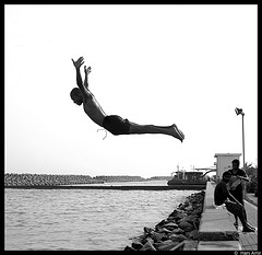 Man diving headfirst into the water