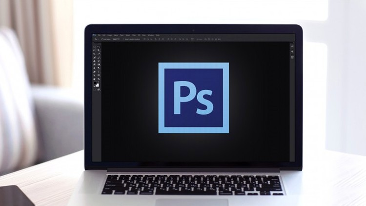 Computer with Adobe Photoshop logo on the screen