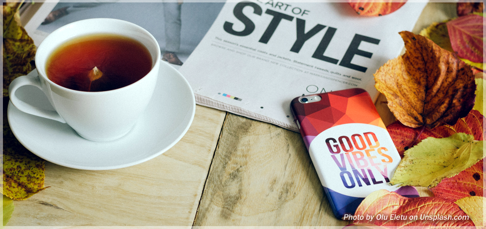 Images of a desk with tea, mobile phone, and a publication.